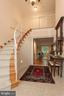 Foyer Spiral Staircase Leads to Upper Level - 6401 STALLION RD, CLIFTON