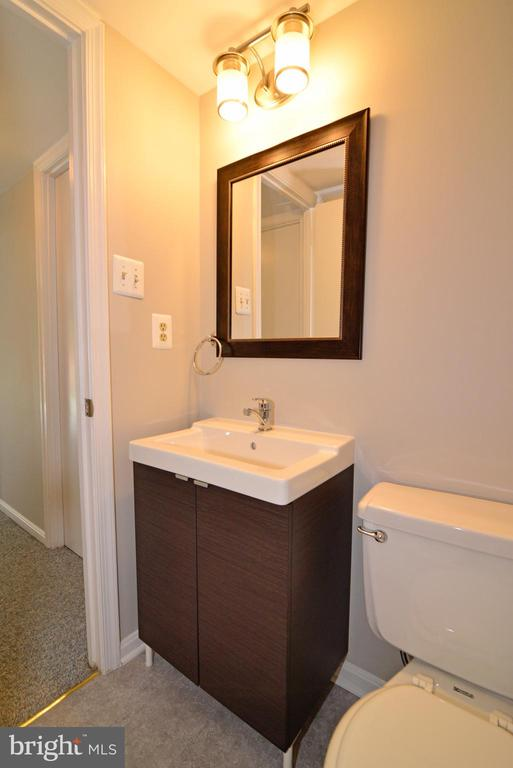 Bathroom 3 with new cabinet and lighting - 218 WILDMAN ST NE, LEESBURG