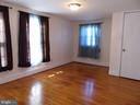 Upper Level 2nd Bedroom has hardwood flooring - 701 SPRING VALLEY DR, FREDERICKSBURG