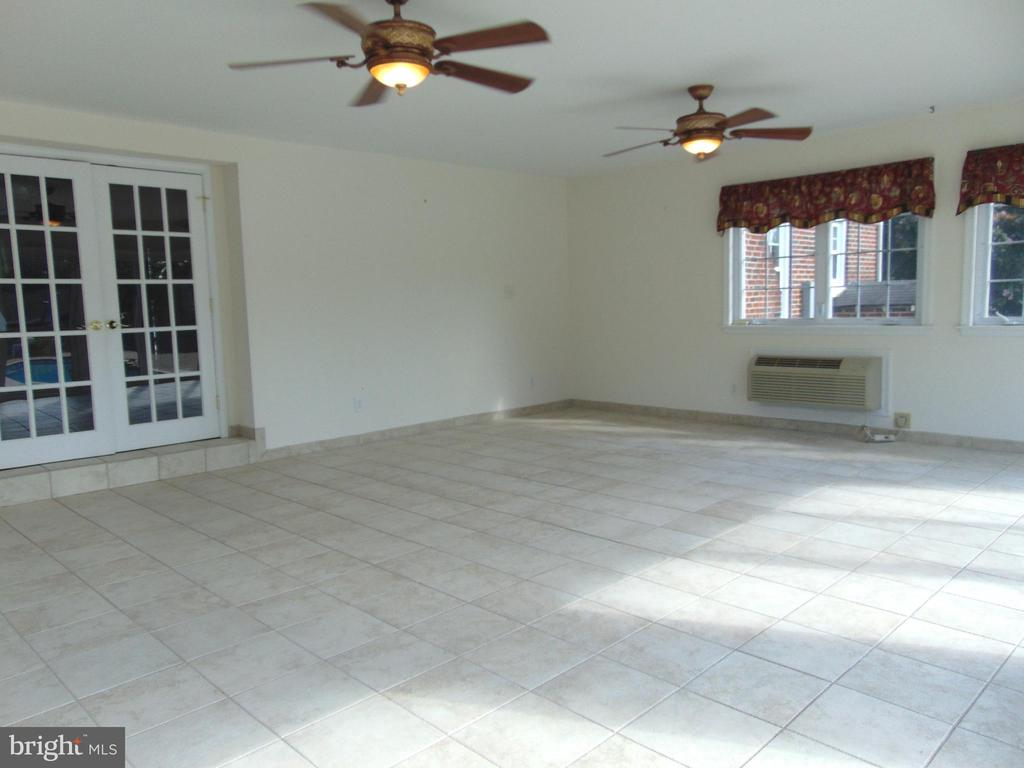 Tile floored Sunroom has separate heat/cool system - 701 SPRING VALLEY DR, FREDERICKSBURG