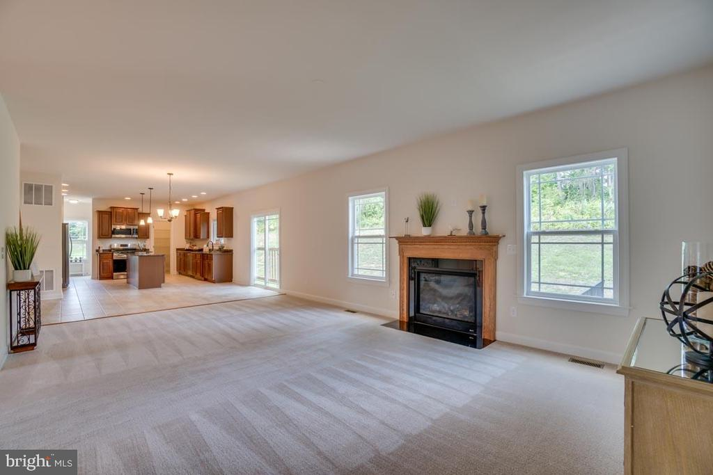 Family room with gas fireplace - 705 KESWICK DR, CULPEPER