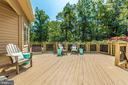 Enjoy the sound of the dam on this deck - 9708 WOODLAKE PL, NEW MARKET
