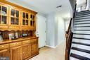 Foyer leads to garage & room with full bath - 8506 SADDLE CT, MANASSAS