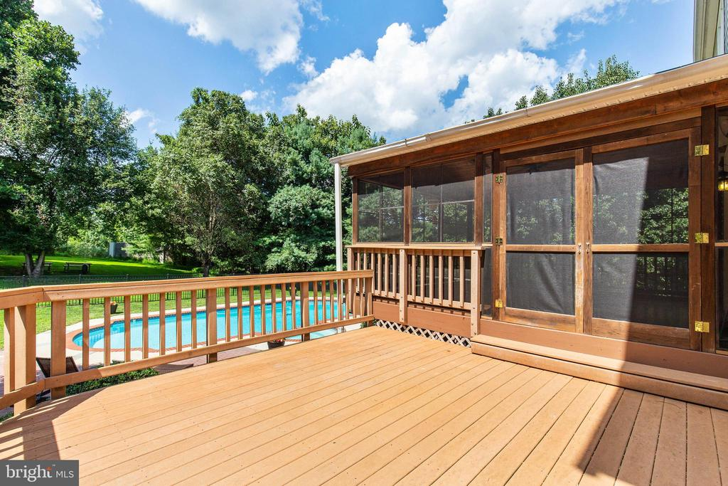 There is a fantastic deck for grilling & relaxing - 9620 CHATHAMS FORD DR, VIENNA