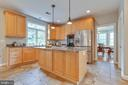 Kitchen has a lovely center island and bar area - 9620 CHATHAMS FORD DR, VIENNA
