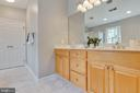 Master bath with dual sinks and cabinet space - 9620 CHATHAMS FORD DR, VIENNA