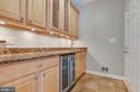 Butlers pantry with wine refrigerator and sink - 9620 CHATHAMS FORD DR, VIENNA