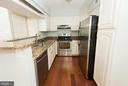 Renovated kitchen boasts granite & SS appliances - 2224 SPRINGWOOD DR #106A, RESTON