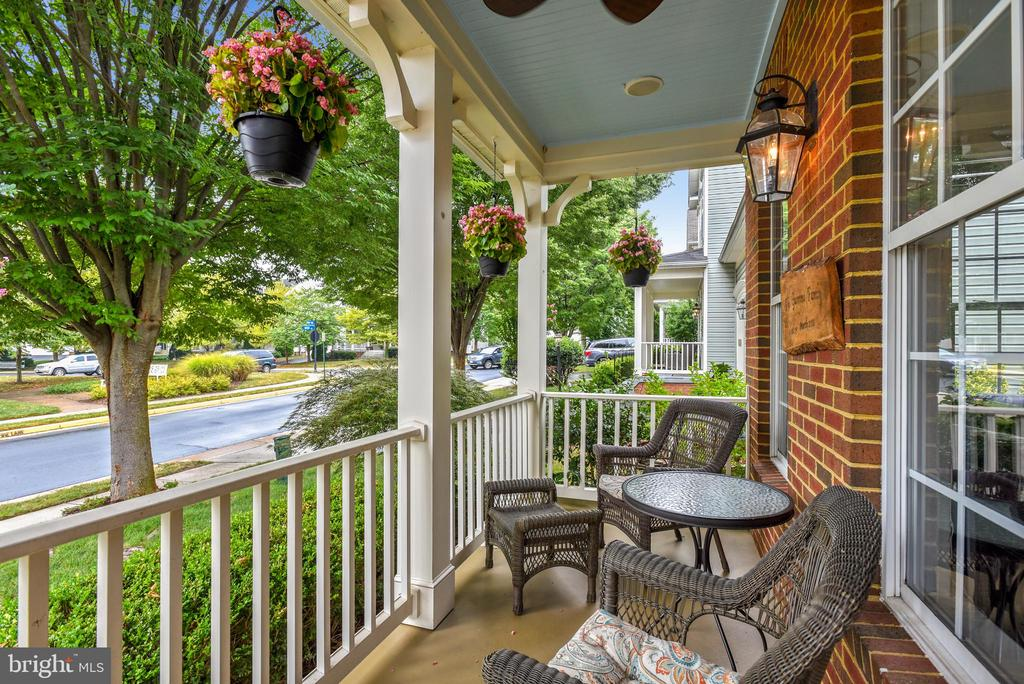 Updated front porch with speakers and ceiling fans - 21536 INMAN PARK PL, ASHBURN
