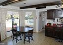Kitchen off mud room with view of  deck and pool - 7839 RIDGE RD, FREDERICK