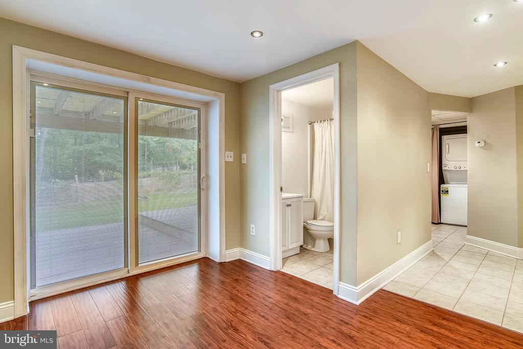 View from Lower level with view of the backyard. - 2996 SLEAFORD CT, WOODBRIDGE