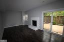 Cozy fireplace in ground level living area - 2265 WHEYSTONE ST, VIENNA