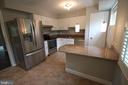 Granite counters & separate bar seating area - 2265 WHEYSTONE ST, VIENNA