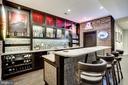 Custom bar with granite countertops - 23039 WELBOURNE WALK CT, ASHBURN