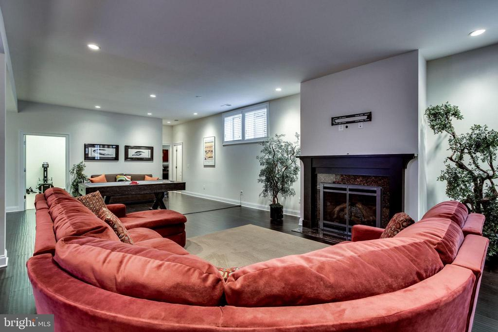 Lower level family room and fireplace - 23039 WELBOURNE WALK CT, ASHBURN