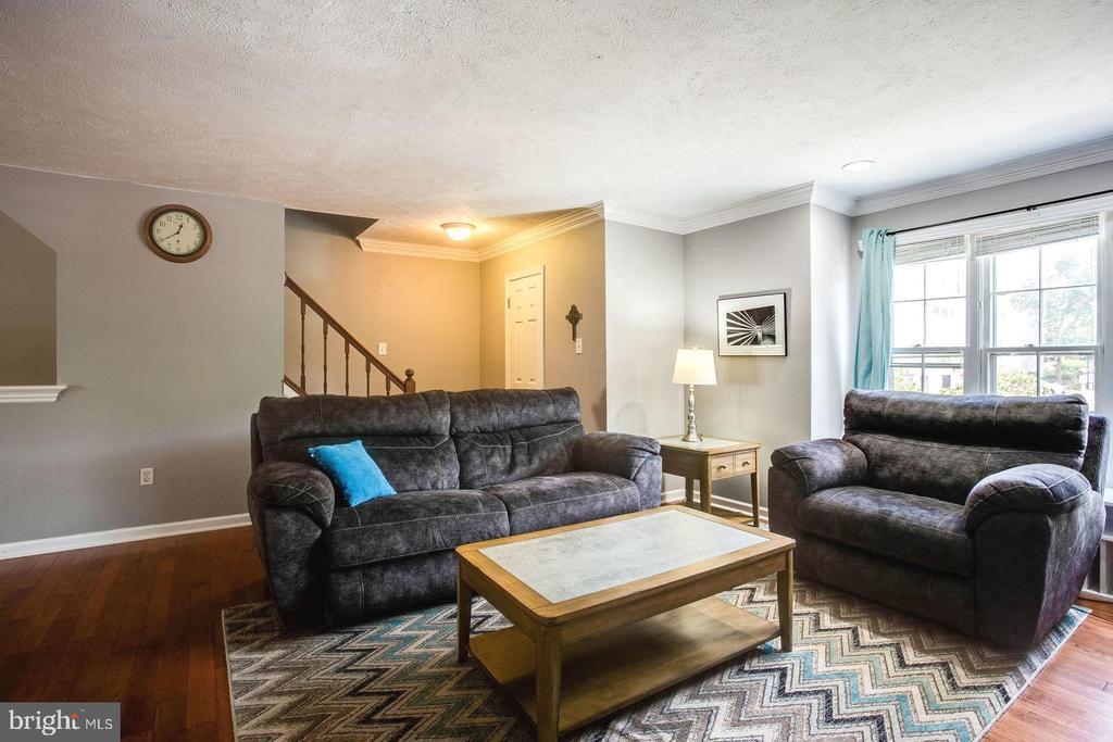 Living room with large windows - 8506 SADDLE CT, MANASSAS