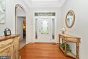 Gleaming Hardwood and Arched Doorways Greet You! - 5944 DUVEL ST, IJAMSVILLE