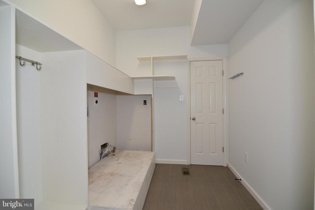 Expanded Laundry Room with walk in Utility Closet - 16901 EVENING STAR DR, ROUND HILL