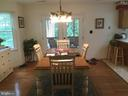 Dining room with french doors leaving deck - 16 LORD FAIRFAX DR, FREDERICKSBURG