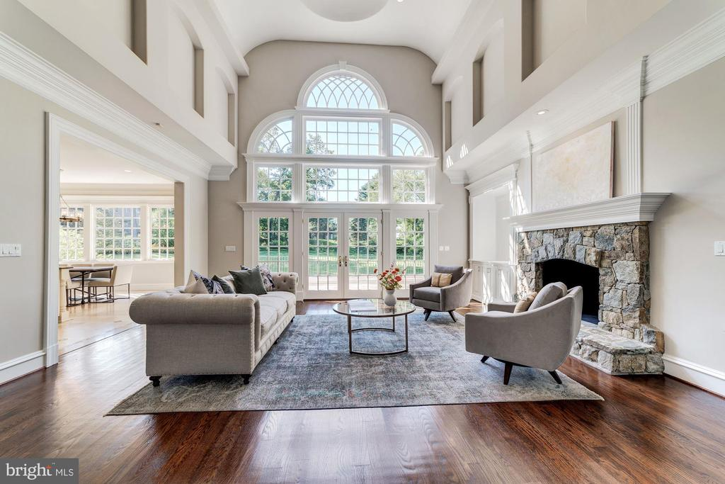 Two story family room with fireplace - 1353 WOODSIDE DR, MCLEAN
