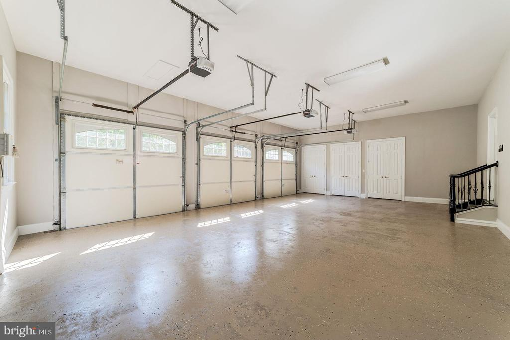 3 car garage with ample storage - 1353 WOODSIDE DR, MCLEAN