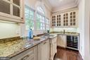 Butler's pantry with dishwasher - 1353 WOODSIDE DR, MCLEAN