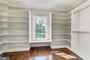 Two walk in closets with practical shelving - 1353 WOODSIDE DR, MCLEAN