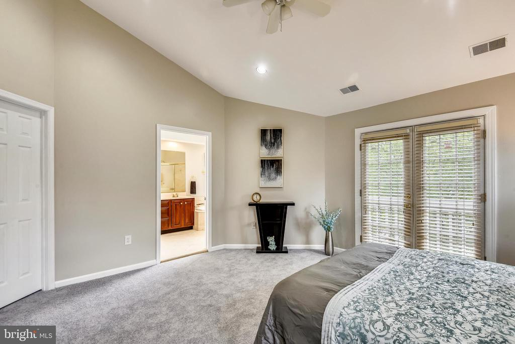 Master bedroom with french doors to balcony. - 8158 BOSS ST, VIENNA