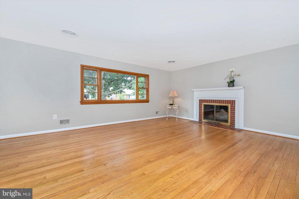 Living Room has wood burning fireplace. - 610 SCHLEY AVE, FREDERICK