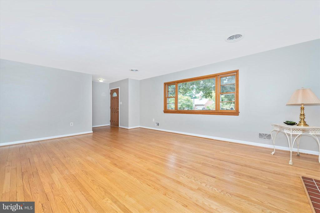 Big front picture window lets in lots of light. - 610 SCHLEY AVE, FREDERICK