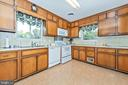 Kitchen has charming 50's solid wood cabinetry. - 610 SCHLEY AVE, FREDERICK