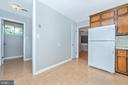 Opens to basement stairs and door to yard. - 610 SCHLEY AVE, FREDERICK
