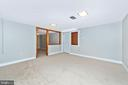 Lower level Family Room opens to kitchenette. - 610 SCHLEY AVE, FREDERICK