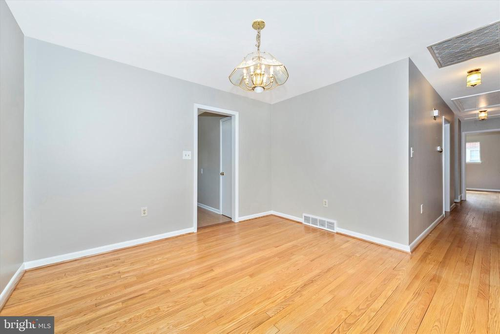 Dining Room w/ door into kitchen; hall to bedrooms - 610 SCHLEY AVE, FREDERICK