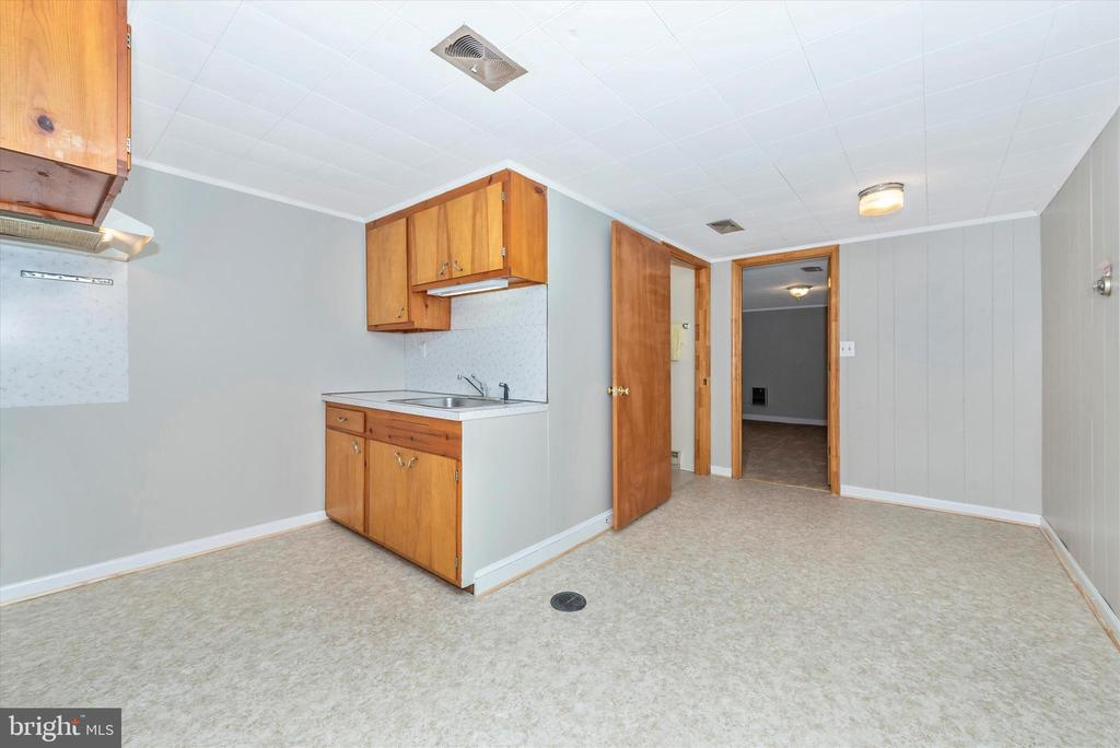 Kitchenette space. New flooring. - 610 SCHLEY AVE, FREDERICK