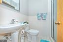Hall Bath has stall shower. - 610 SCHLEY AVE, FREDERICK