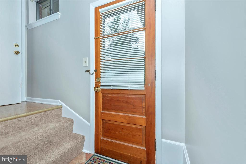 Stair connecting from kitchen to basement to yard. - 610 SCHLEY AVE, FREDERICK