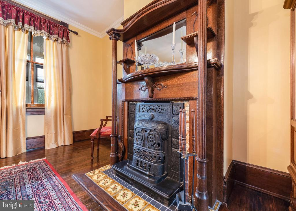 One of 3 fireplaces in dining room (ornamental) - 9309 WHISKEY BOTTOM RD, LAUREL