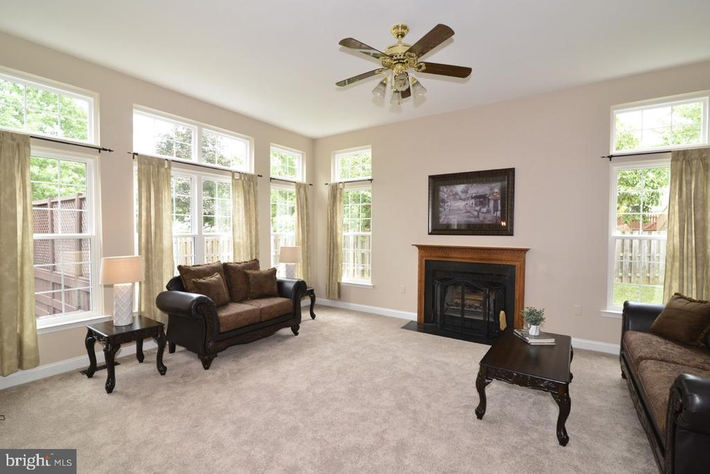 Light-filled family room with fireplace. - 1308 FEATHERSTONE LN NE, LEESBURG