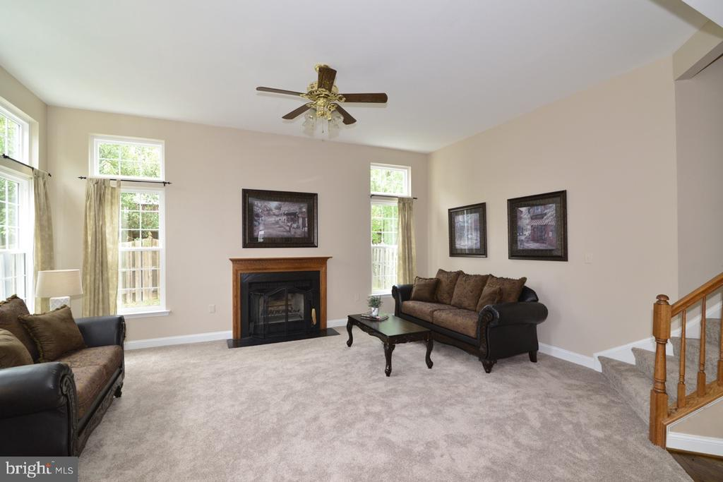 High ceilings, large windows and plush new carpet! - 1308 FEATHERSTONE LN NE, LEESBURG