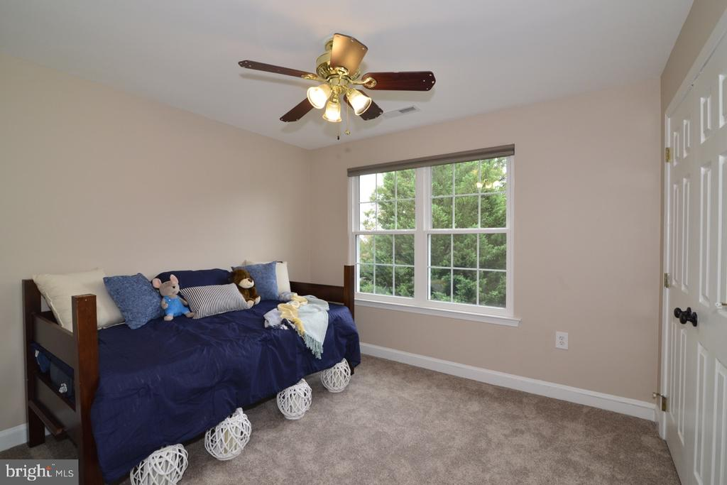 Spacious second bedroom with new carpet and light. - 1308 FEATHERSTONE LN NE, LEESBURG