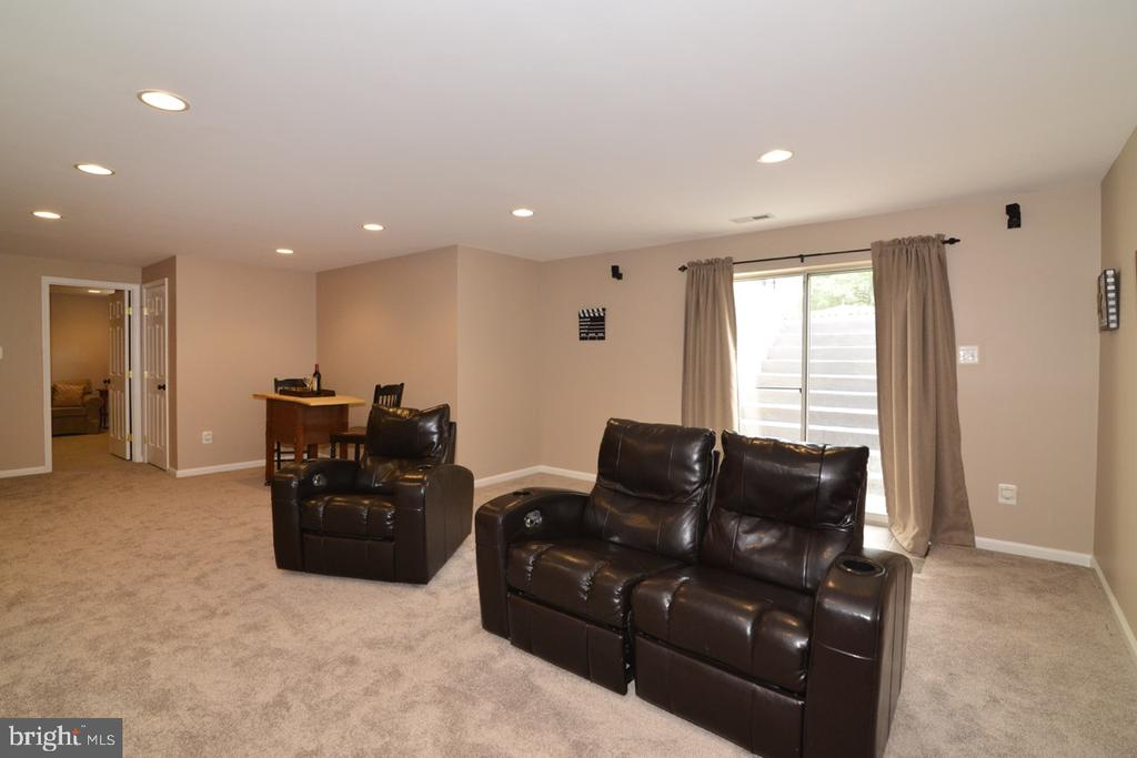 Basement walks up to backyard. - 1308 FEATHERSTONE LN NE, LEESBURG