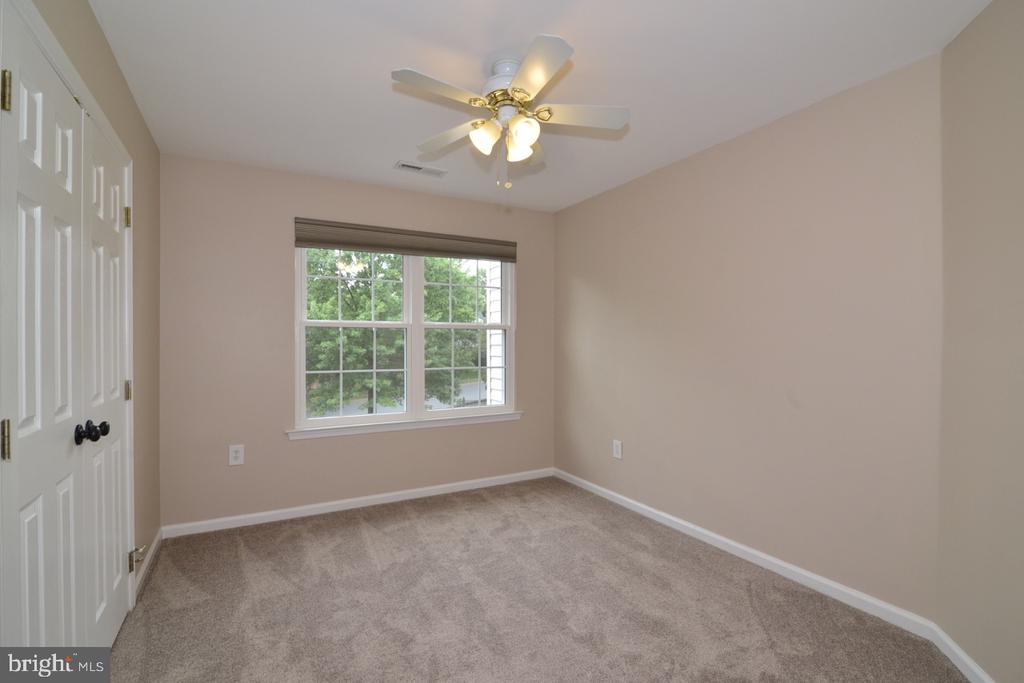 Lovely third bedroom with new carpet and light. - 1308 FEATHERSTONE LN NE, LEESBURG