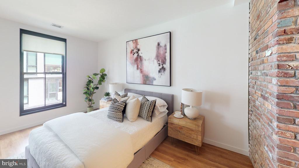 Large bedroom with original 1906 brickwork. - 57 N ST NW #H-306, WASHINGTON
