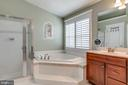 Masterbath with soaking tub and separate shower - 20062 NORTHVILLE HILLS TER, ASHBURN