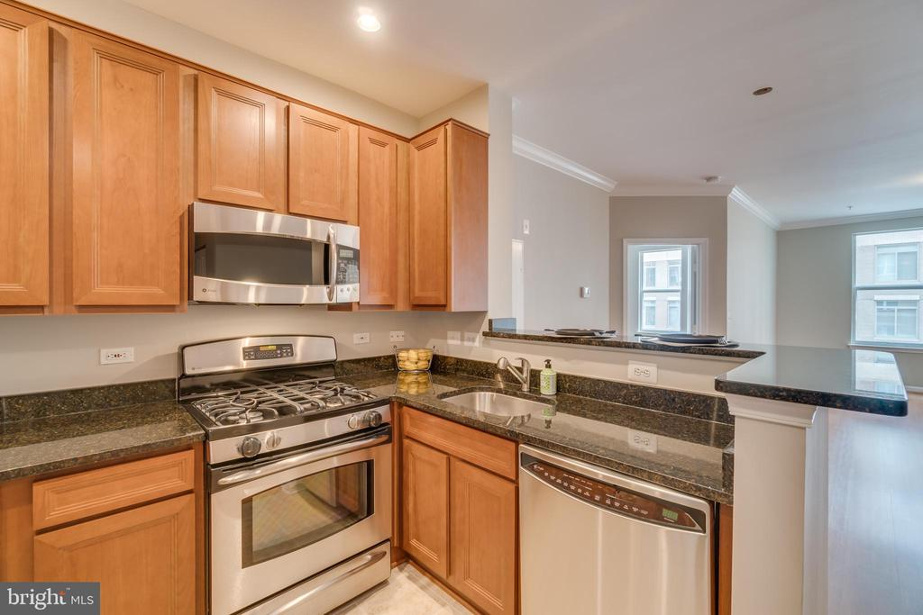 Kitchen is open to the living space - 12000 MARKET ST #254, RESTON