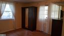 Lower level bedroom  - with door leading to patio - 6216 STONEHAM RD, BETHESDA