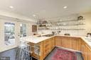 Gourmet kitchen with access to outdoor dining area - 3610 QUEBEC ST NW, WASHINGTON