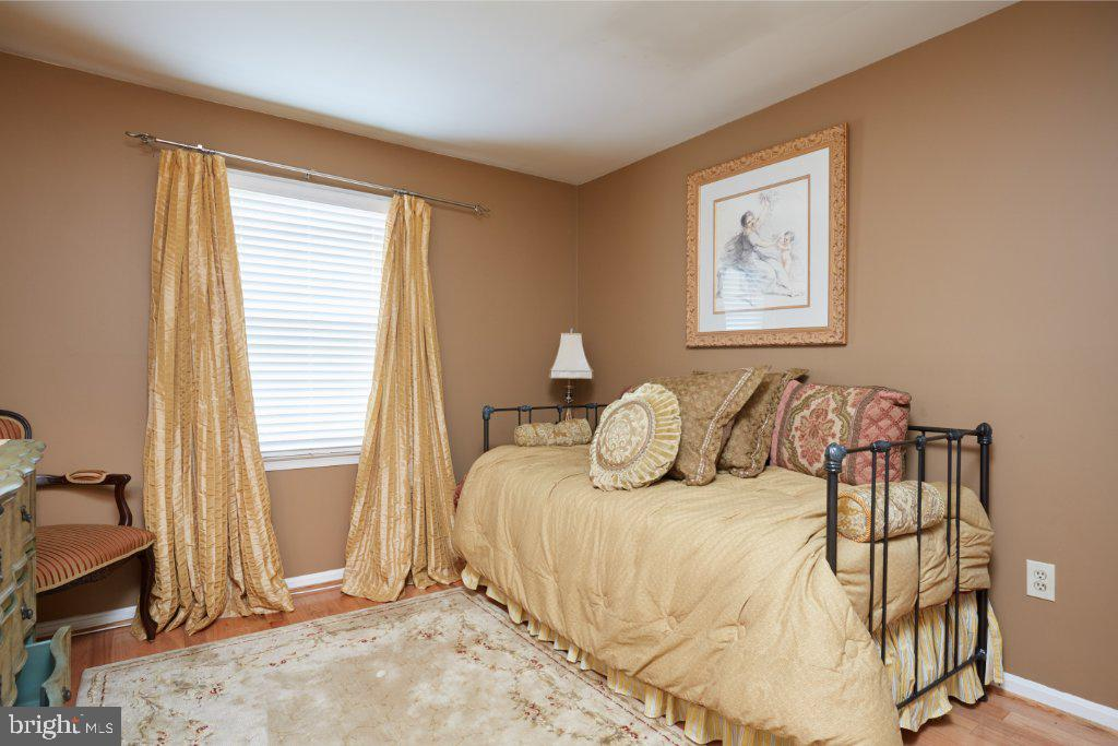 Bedroom 2 with elegant curtains and shades - 2028 GALLOWS TREE CT, VIENNA