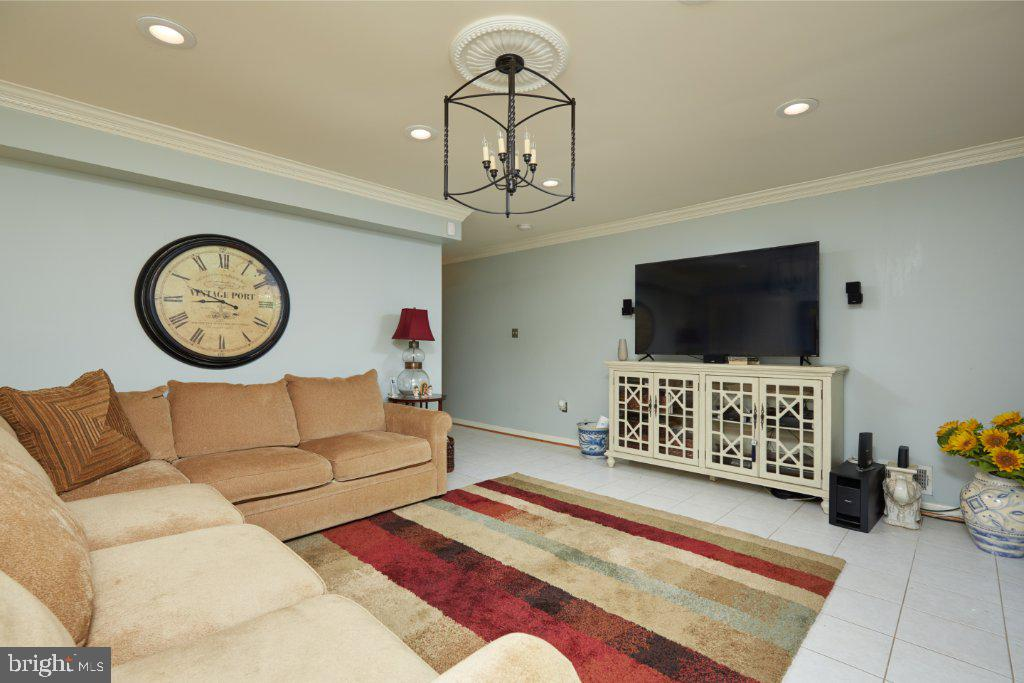 Lower level Family Room with ceramic tile flooring - 2028 GALLOWS TREE CT, VIENNA